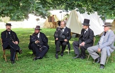 Civil War period actors relax on the grounds of Fulton's Birthplace.  A Civil WA\ar re-enactment has become an annual event at the site.