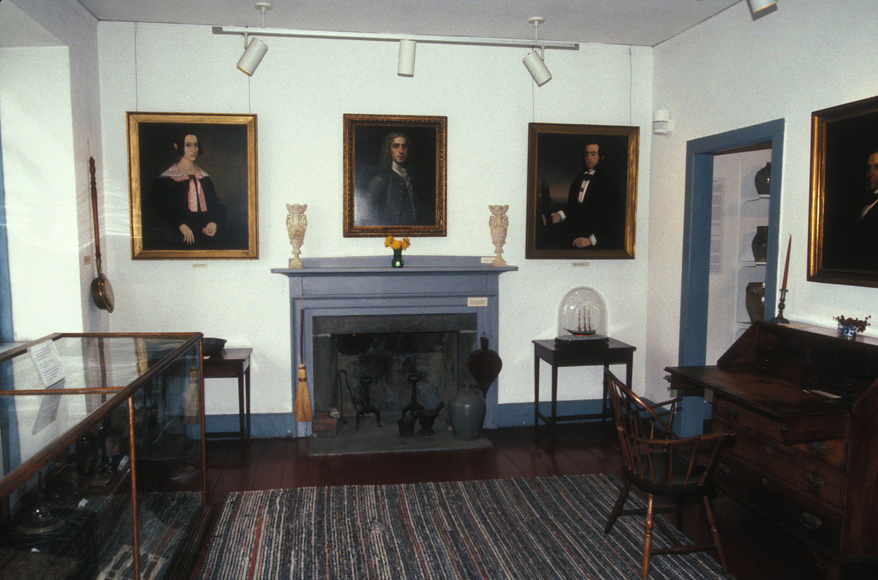 Paintings and other items are on display inside.