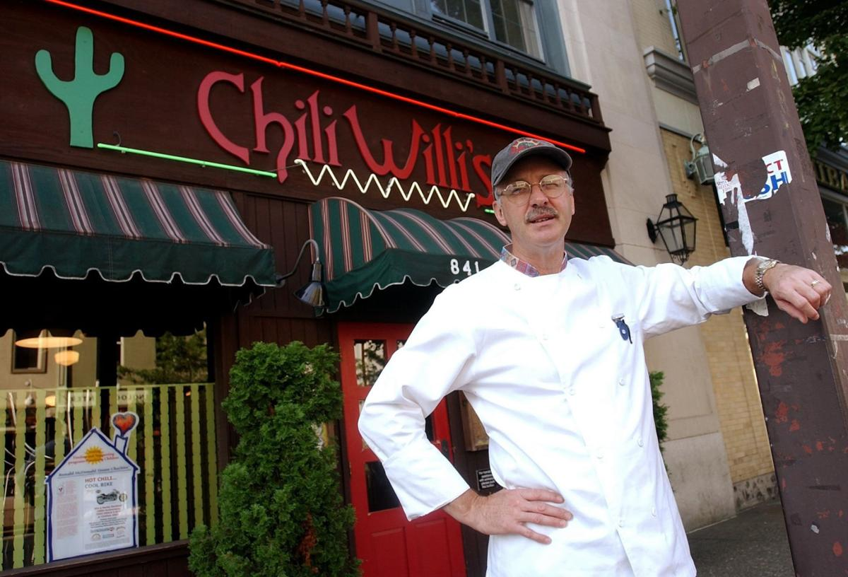 Ron Smith poses outside Chili Willi's second location