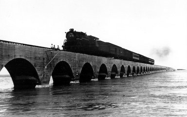 Train going over the bridge south.