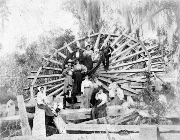 People Posing On The Water Wheel (1897)