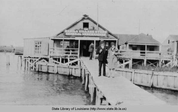 Taken around 1883 of fishing village of Saint Malo on the shore of Lake Borgne.