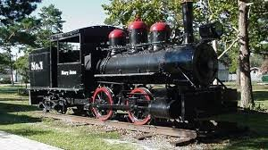 """This is one of the one of the """"baby trains"""" that is located on the side of the Orphan Train Museum."""