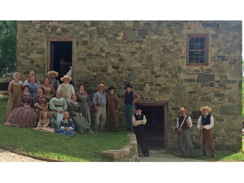 Period actors pose near the mill during one of their educational programs.
