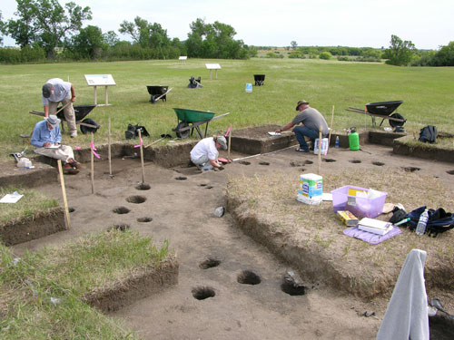 Archaeologist team excavating a house at the Huff site.