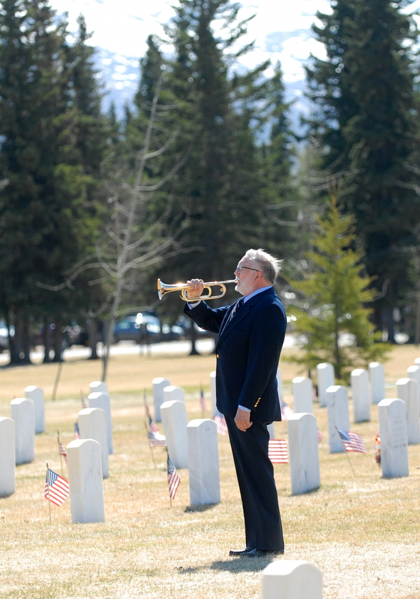 A bugler playing at a Memorial Day Ceremony at Fort Richardson National Cemetery
