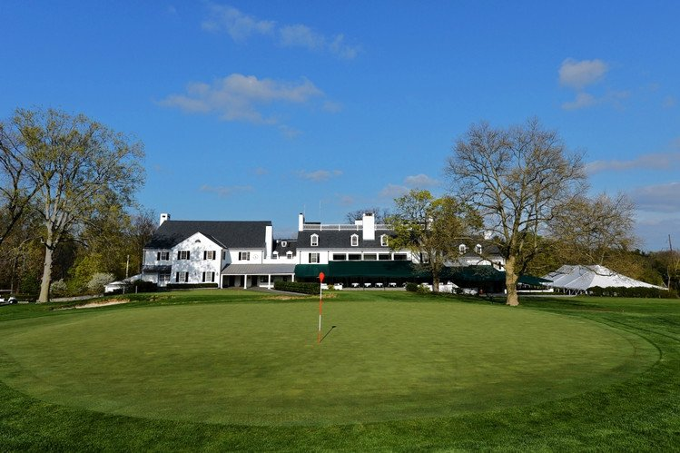 Merion's clubhouse sits behind its 18th green.
