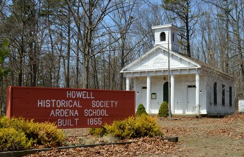 The sign in front of the Old Ardena School House recognizes the Howell Historical Society's role in maintaining the historic site.  It also includes the date of the second structure that was built in 1855.
