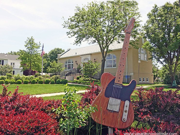 The Bruce Springsteen guitar art piece can be seen on the grounds of the library.  Photo from: Christine Cardellino, The Patch