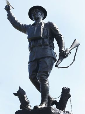 Image of the front of the Viquesney Spirit of the Doughboy statue, featuring the vandalism of the rifle. The vandalism occured in June of 2017. It has since been repaired, and cost $17,000.