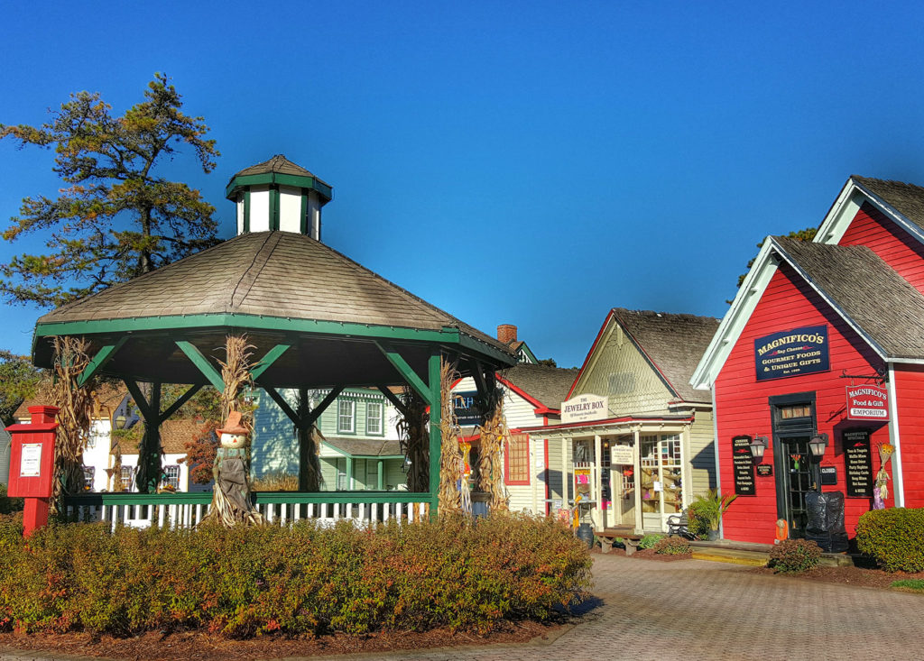 This image shows the heart of one side of the town, where the local shops all face toward a quaint gazebo. Photo from historicsmithville.com.