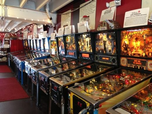 This is picture 5 of 5, credited to photographer Joseph Murphy, that shows another row of what type of pinball games would be at Silverball Museum Arcade. Another example that is clearly visible is an Indiana Jones pinball game.