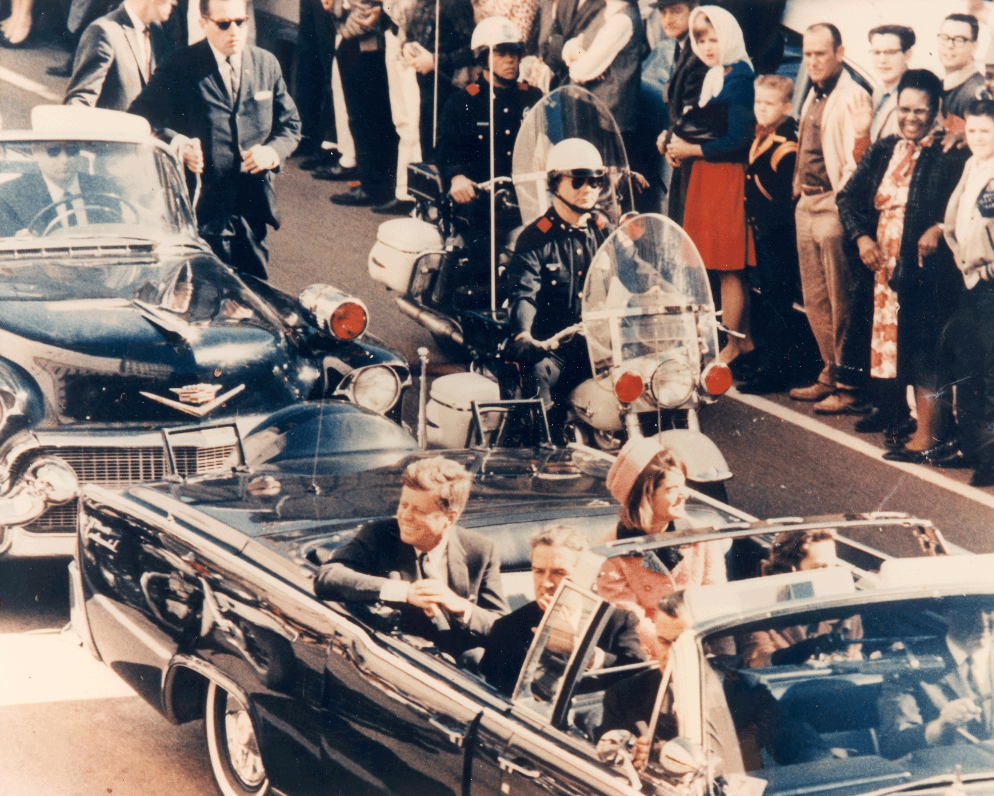 President Kennedy and the first lady riding through Dealey Plaza just minutes before the gun shot.
