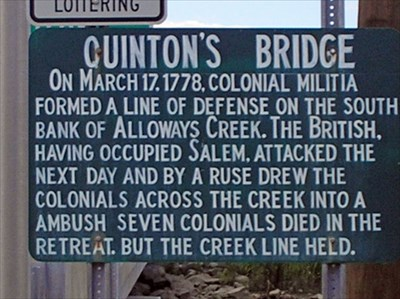 Sign at intersection at Quinton-Alloway Rd before crossing Quinton's Bridge
