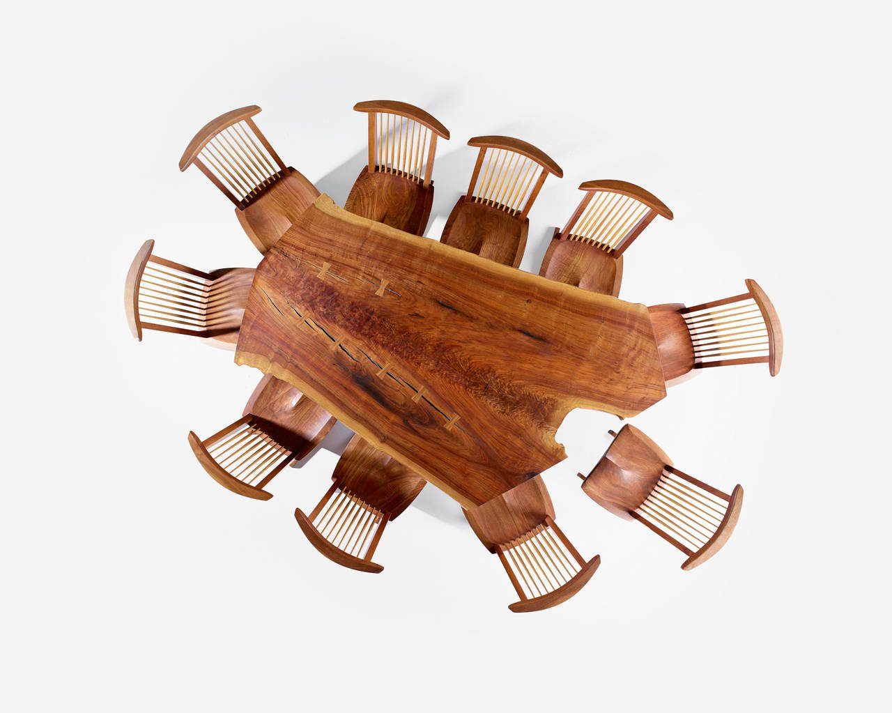 An overhead shot of a Nakashima dining table and chairs.