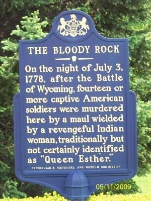 "The marker says that ""On the night of July 3, 1778, after the Battle of Wyoming, fourteen or more captive American soldiers were murdered here by a maul wielded by a revengeful Indian woman, traditionally but not certainly identified as Queen Esther."