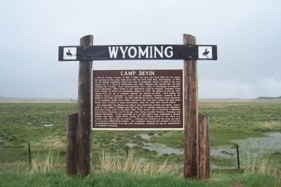 The marker of Camp Devin located of the highway to the right when traveling north on WY-112 N
