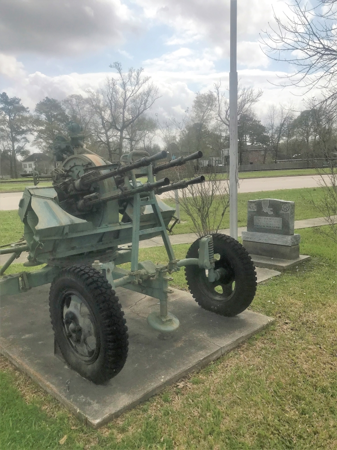 Photo taken February 28, 2018. Retrieved from: https://www.hmdb.org/Photos4/417/Photo417851o.jpg  Part of the Kinder War Memorial, this decommissioned artillery makes the 1st. Lt. Douglas B. Fournet Memorial easily spottable from the road.
