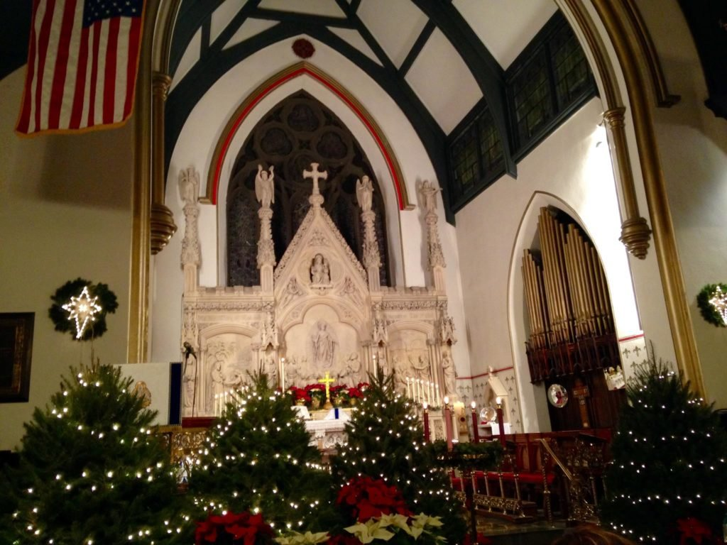 St. Mark's transept decorated for the holidays with the carved reredos in the background.