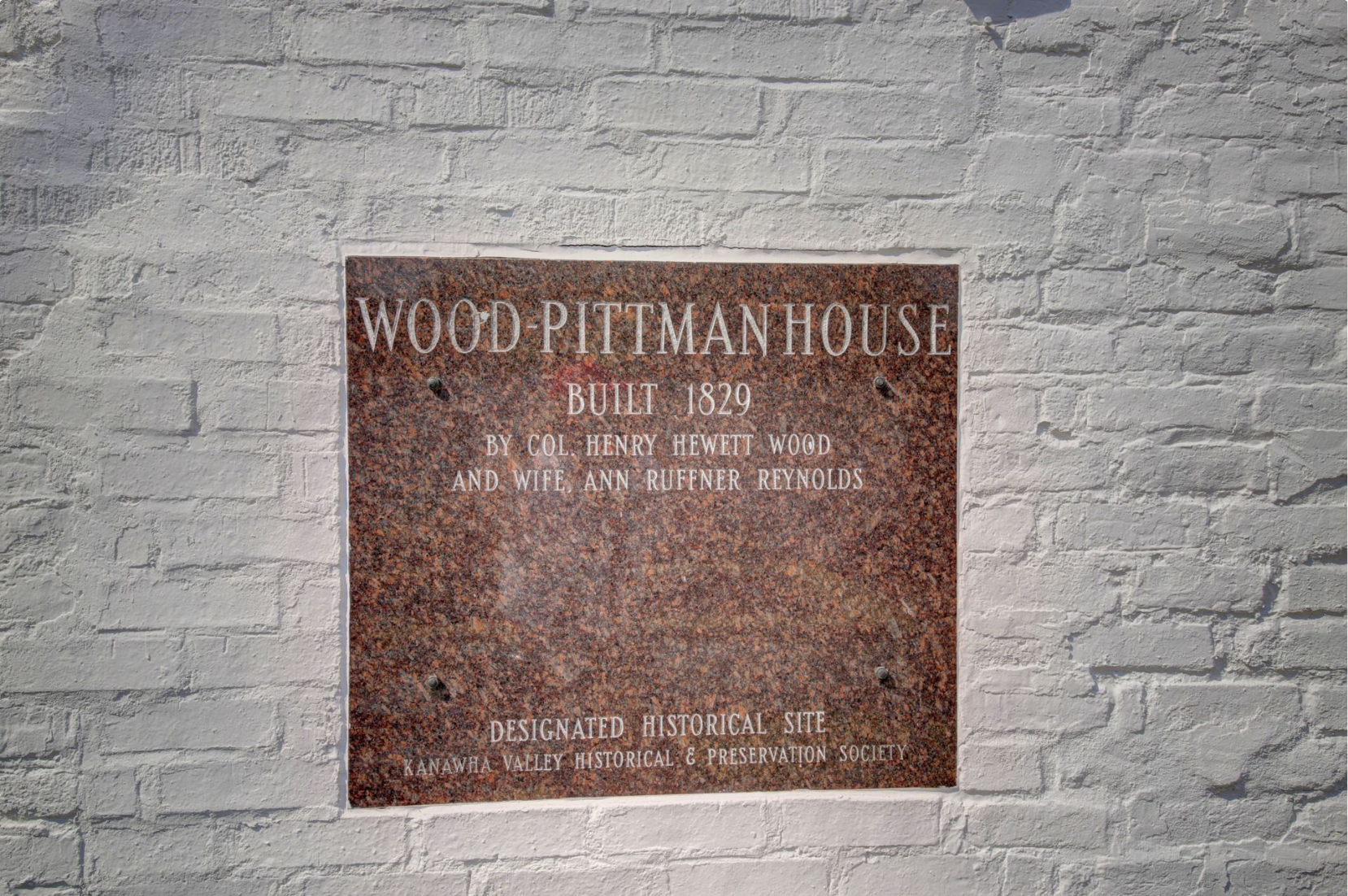 Plaque noting the historical significance of the house