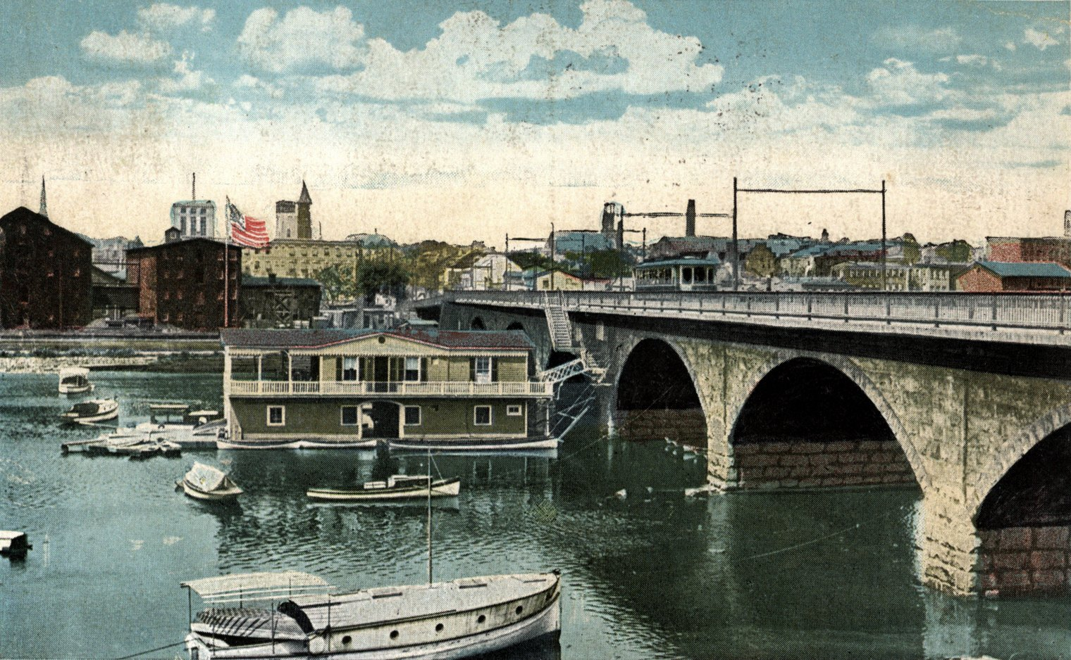 Postcard (ca. 1930) showing the Albany Street Bridge with the boathouse and trolley service.