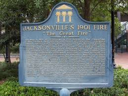 "Plaque for the Great Fire of 1901. "" On May 3, 1901 at 12:30 p.m., a fire began at the Cleaveland Fibre Factory, ten blocks northwest of this site. Chimney embers ignited sun-dried moss to be used as mattress stuffing. Fueled by wind and dry weather, the fire roared east destroying most structures in its path. By 3:30 p.m., the fire reached this site, then called Hemming Park. The park and its renowned live oaks were devoured by the flames and only the Confederate Monument survived, its base glowing red from heat. The fire continued an eastward march to Hogan's Creek, where a citizens'? bucket brigade stayed the flames. Then, turning south, the inferno roared to Bay Street's riverfront docks. Extreme heat caused a waterspout in the river where rescue boats trolled for survivors. The fire was so intense, black smoke clouds could be seen as far away as South Carolina. As flames moved west on Bay Street, the firefighters? gallant stand and dying winds brought the fire under control by 8:30 p.m. In just eight hours, nearly 10,000 people were homeless, 2,368 buildings were lost, 146 city blocks were destroyed, but miraculously only seven people perished. Jacksonville's 1901 Fire remains the most destructive burning of a Southern city in U.S. history."""