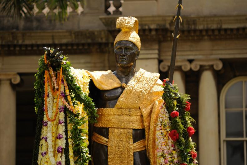 This is the second statue located in front of the Iolani Palace in Honolulu. This photo is taken after the Hawaiian people have placed lei onto the statue to celebrate the June 11 holiday.