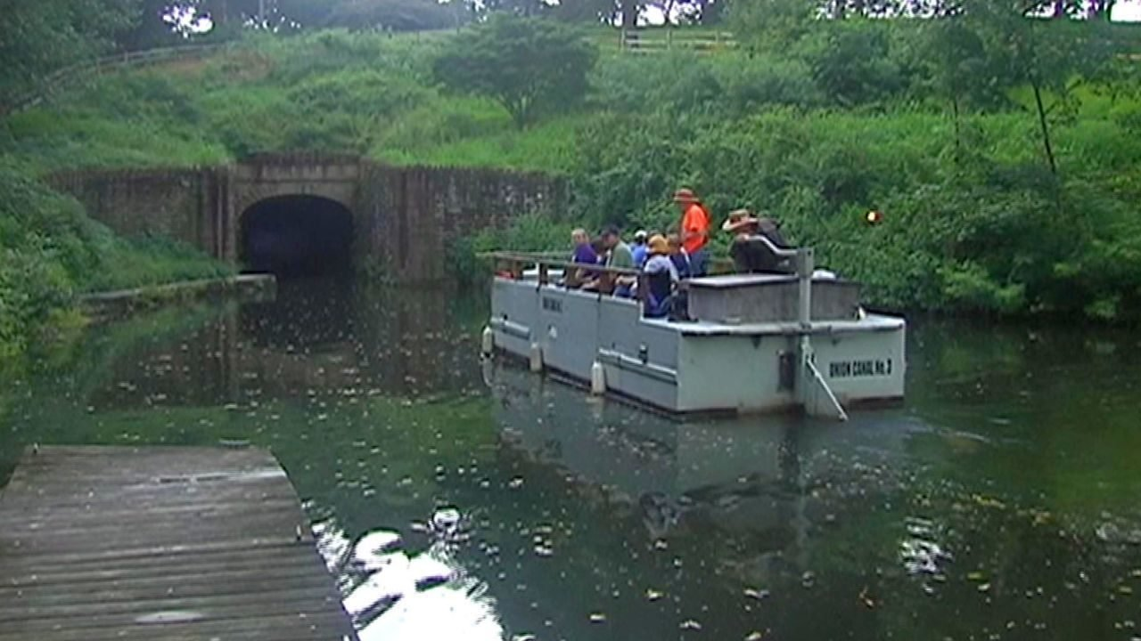 A tour boat heads into the Union Canal Tunnel.