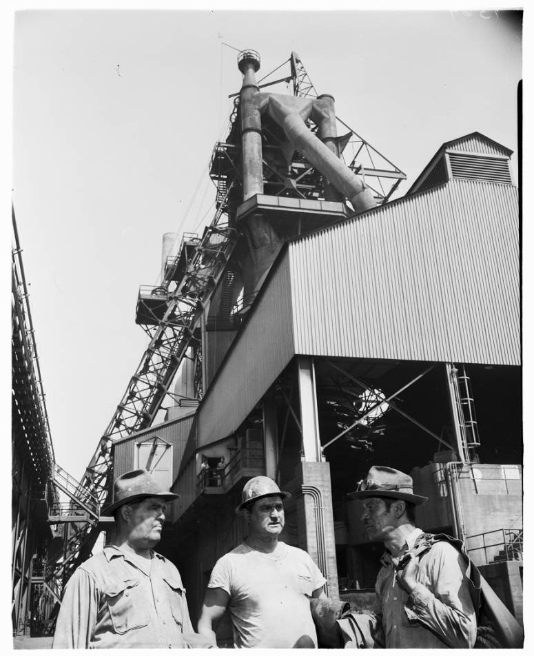 Workers with part of the massive mill in the background in 1952. At its height, the plant had over 10,000 workers on payroll (USC Digital Archives).