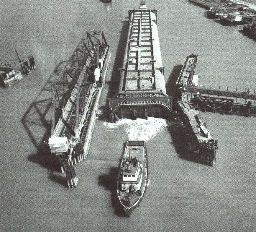 Tugs tow a section of the Bay Area Rapid Transit's (BART) underwater Transbay Tunnel into place in the 1960s. Kaiser Steel produced the structural steel for the undertaking (Kaiser Steel Archives).