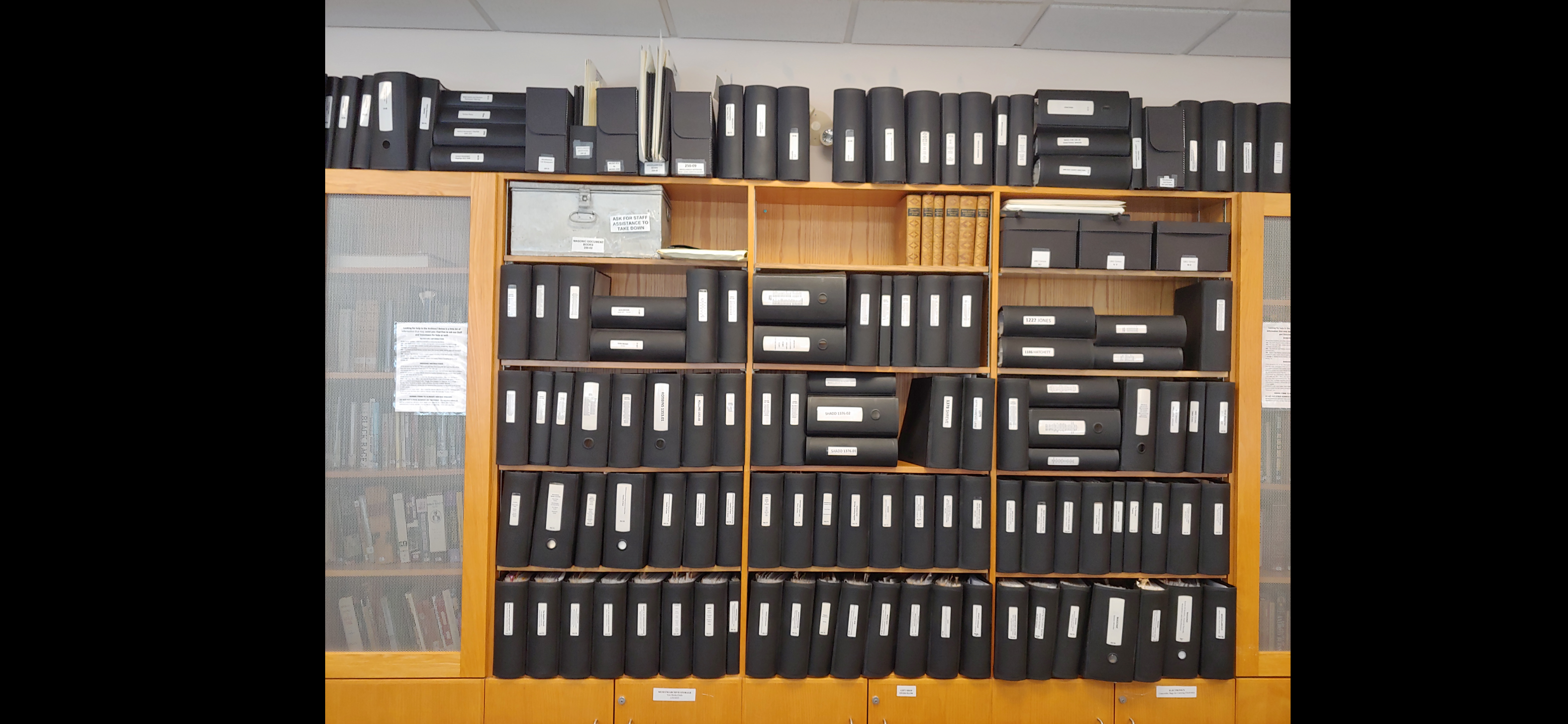 The image is of the CKBHS's collection of binders that hold family histories of Chatham locals. The museum has dedicated years to creating a thorough and comprehensive collection that shares the stories of the community members past and present.