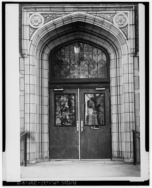 When Northcott Hall was demolished, the stone arch entrance was preserved and used in the design of the library as a window.