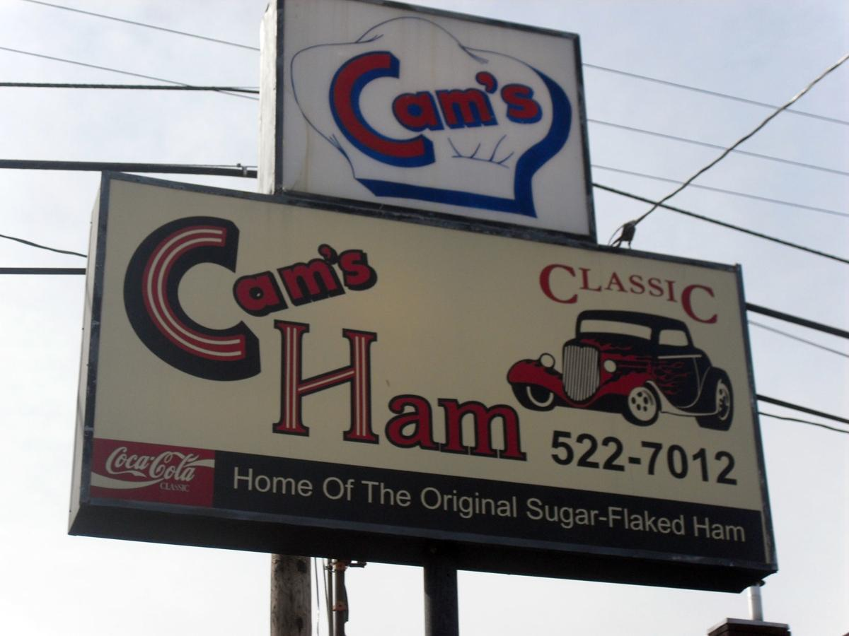 Signs outside Cam's Ham