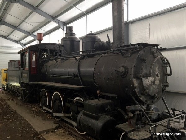 A steam locomotive on display in one of the museum's out buildings.