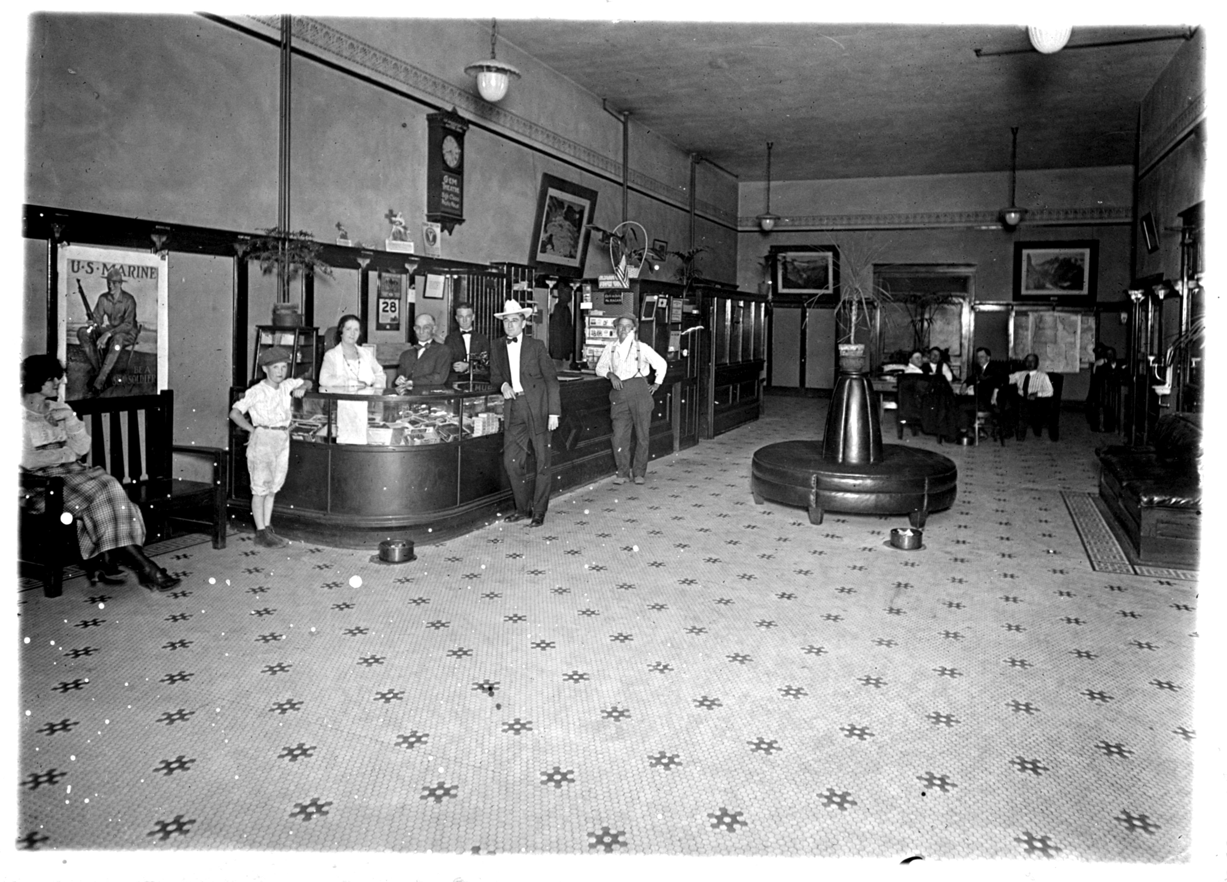 Photo of the lobby of the Wenatchee Hotel, persons unidentified.  The hotel operated from 1910 - 1965.