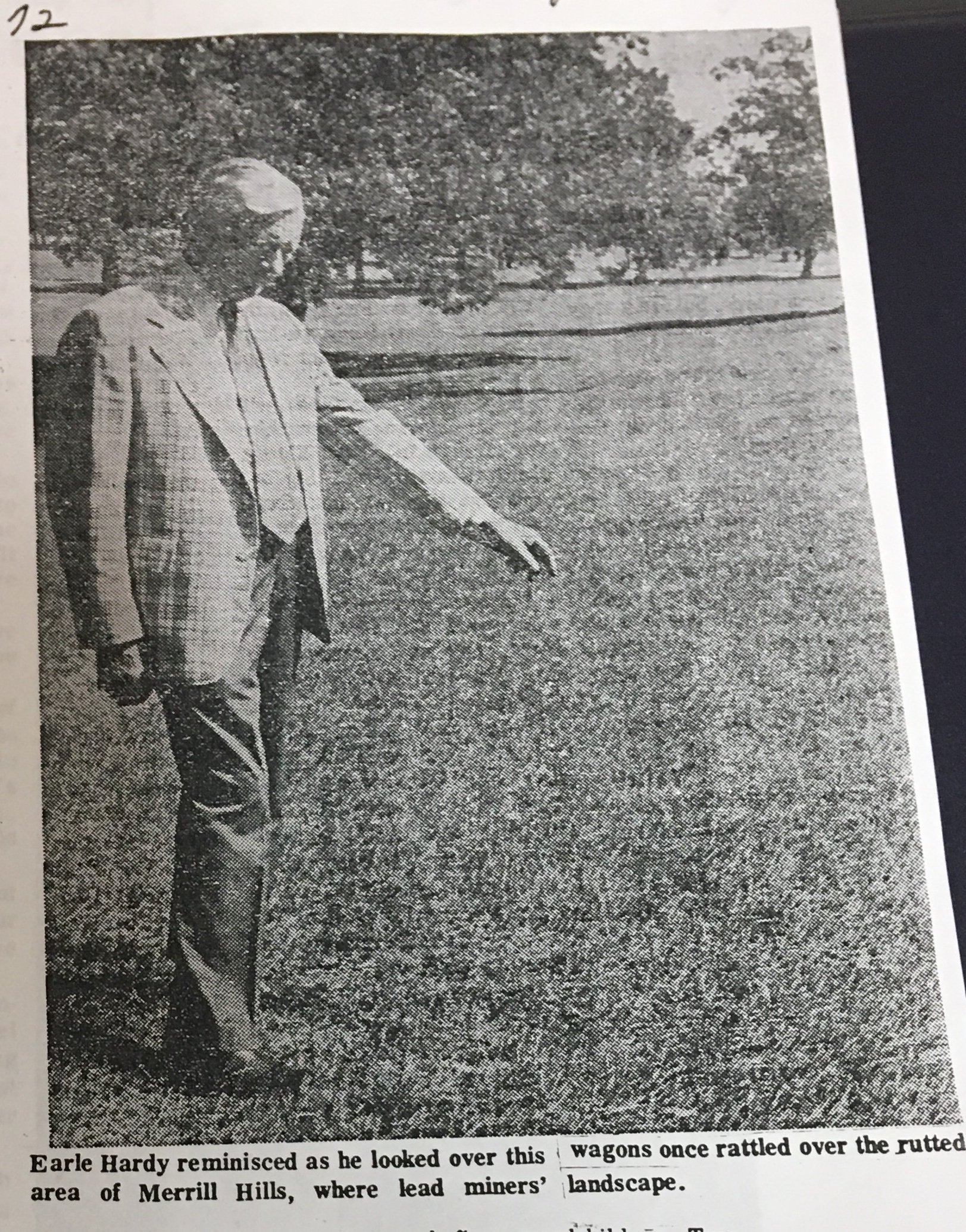 Earl is shown pointing to the spot where he investigated a cow that had been struck by lightning for insurance company at which he worked. He concluded that the land he was looking at was the perfect place on which to build a golf course.