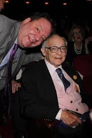 James M Nederlander and his son, Jimmy Nederlander smile for a picture while watching one of the shows in their theatre.