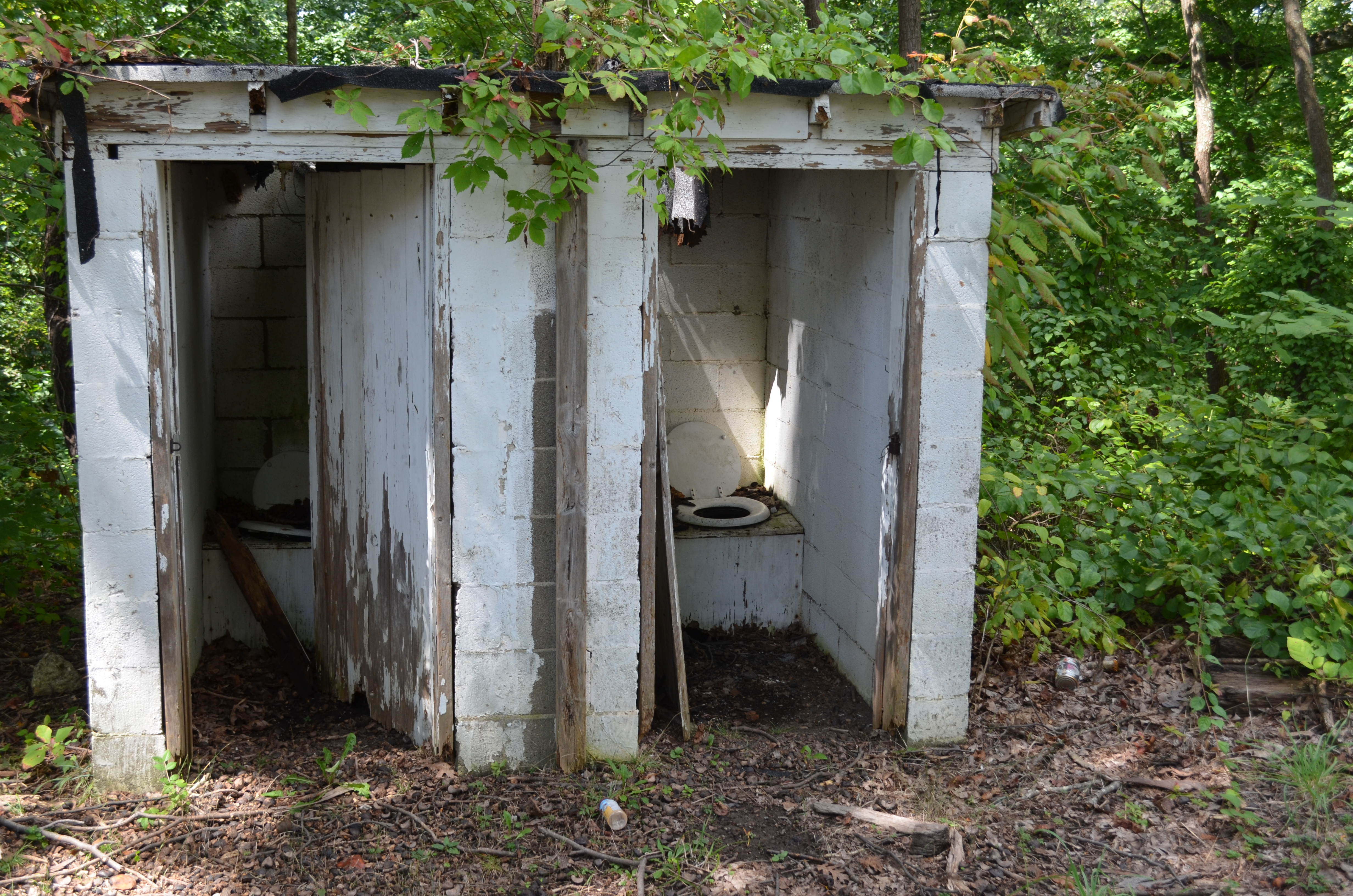 The structure includes several original buildings, such as these outhouses