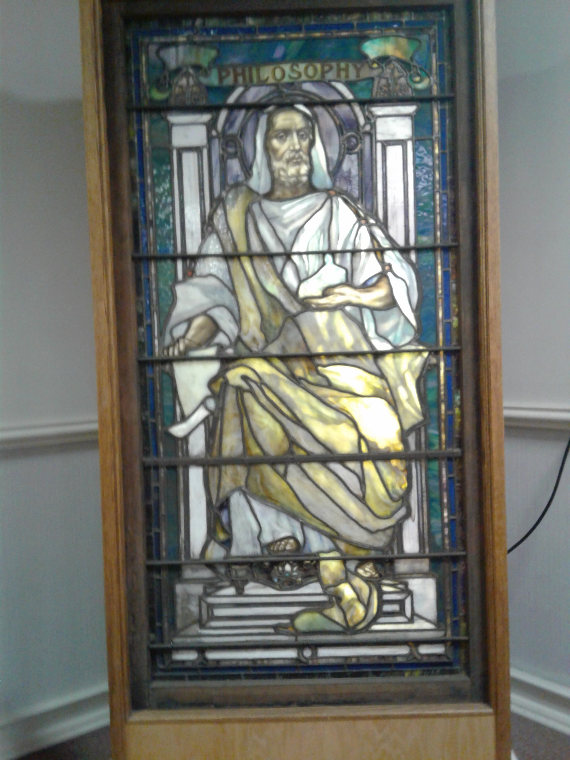 One of nine original stained glass windows commissioned by Frances Jones. This window represents the personification of Philosophy. Each of these windows originally hung in the original Jones Memorial Library.  ~Courtesy Jones Memorial Library~