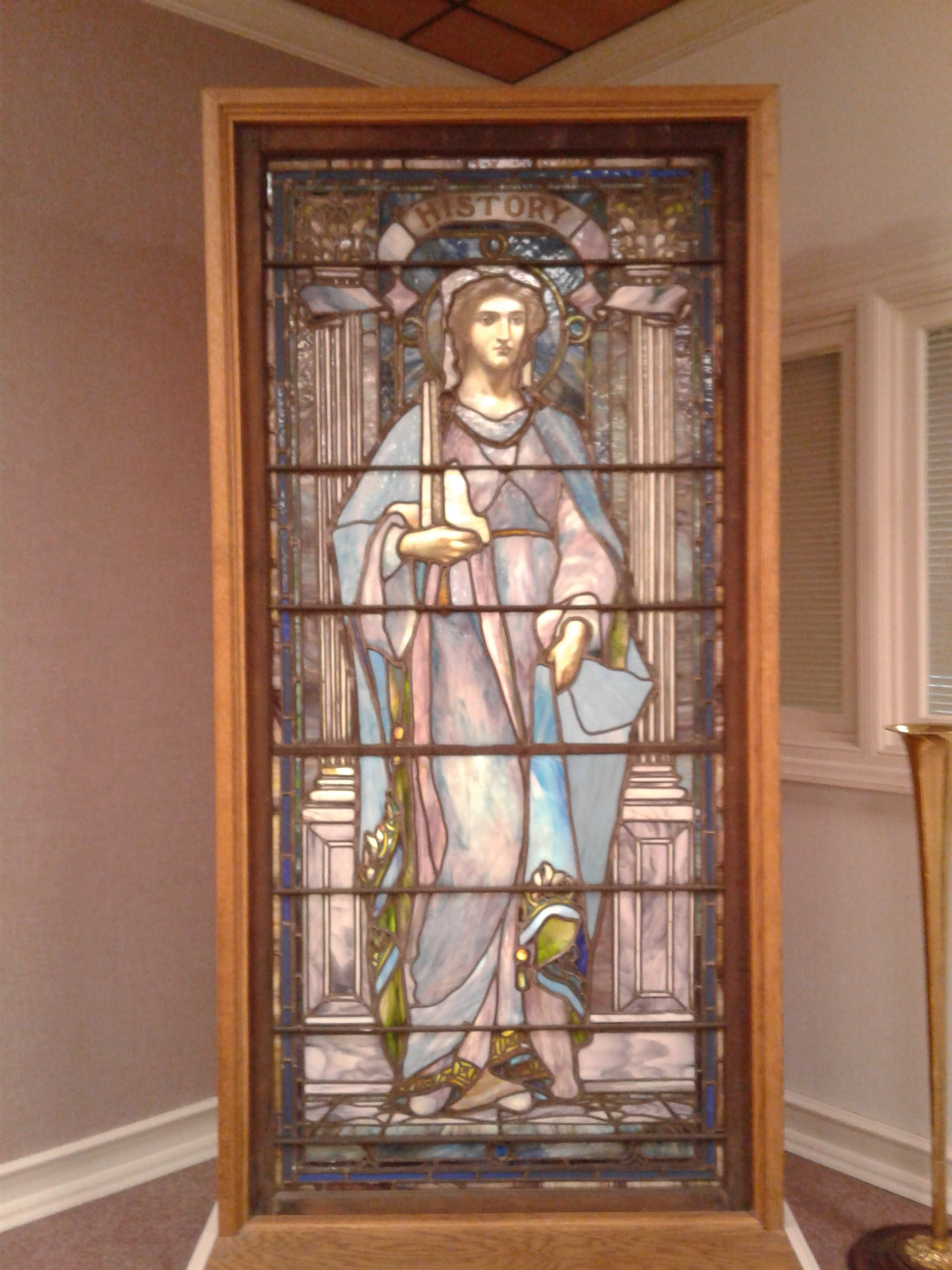One of nine original stained glass windows commissioned by Frances Jones. This window represents the personification of History. Each of these windows originally hung in the original Jones Memorial Library.  ~Courtesy Jones Memorial Library~