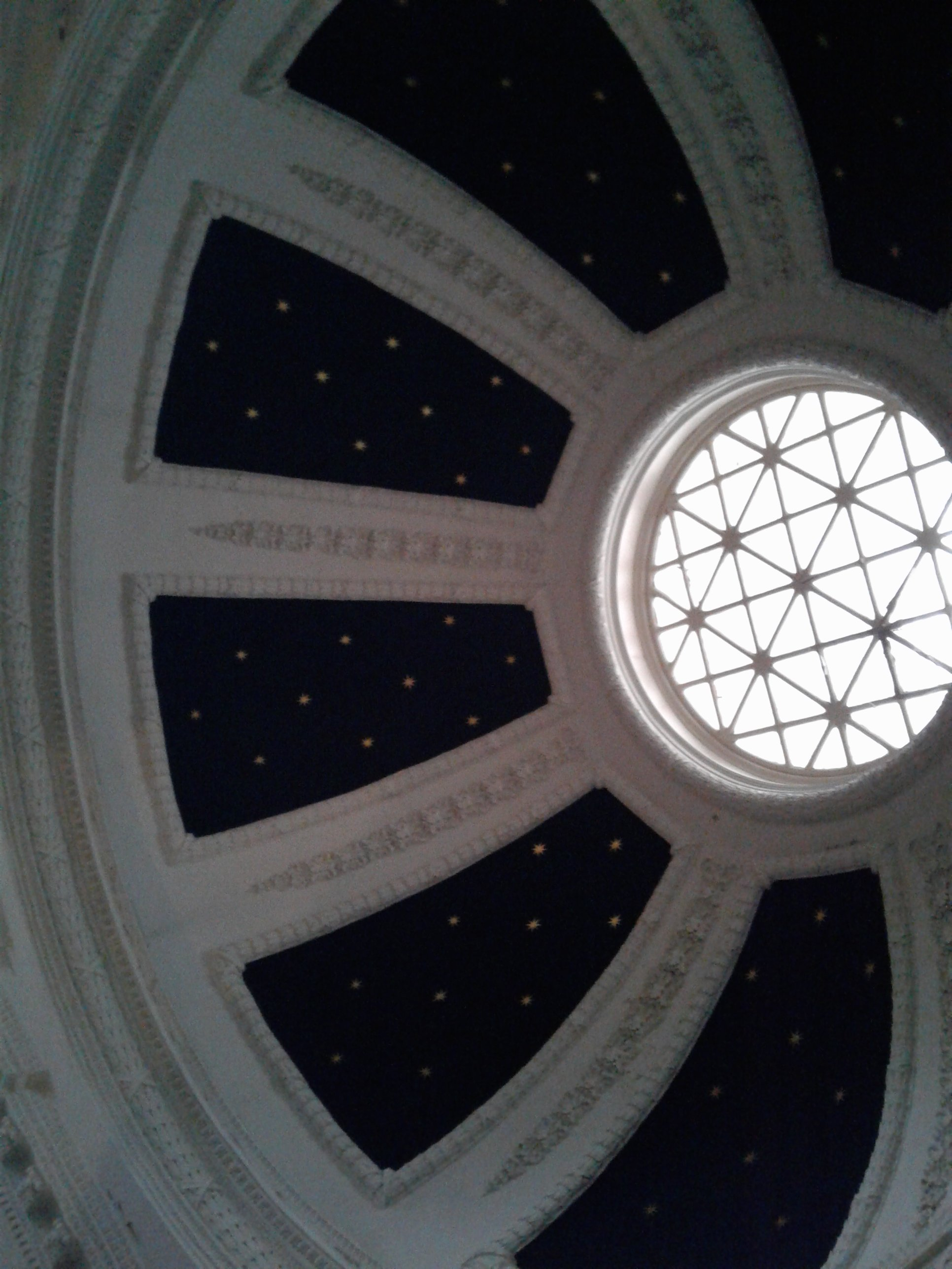 Historic Jones Memorial Library Interior View of Dome. Glass skylight surrounded by panels that look like stars in the night sky, with molding around each panel.