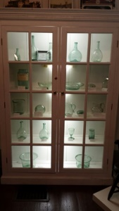 Historical glassware on display within the museum.
