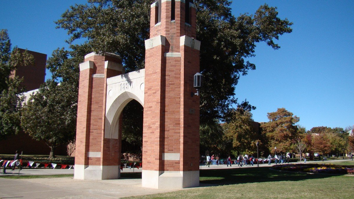 This is a more recently taken photo of the Centennial Arches on OU's Campus. In the background are hundreds of students heading to class.