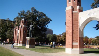 "A photo of the arches from a different angle and with a greater field of view.  Here you can see both sets of arches and the infamous ""Seed Sower"" statue that is modeled after the University's first president, David Ross Boyd.