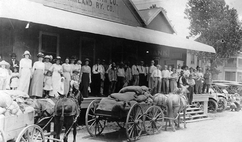 An image from circa 1908 which shows workers standing outside a bank which had been established by the Imperial Sugar Company. Germans and Czechs made up a large part of the Sugar Land population.