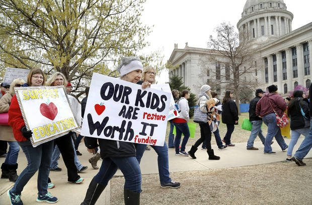 """Teachers from throughout the state converged at the Capitol to bring their concerns about education funding to the attention of legislators and state officials... on Monday, April 2, 2018."" Photo by Jim Beckel, The Oklahoman."