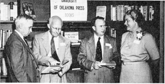 (left to right) Van Endicott, superintendent of the University Press; Will Ransom, art editor; Savoie Lottinville, director of the Press; and Mary Stith, assistant editor at openhouse of new press building in 1948.