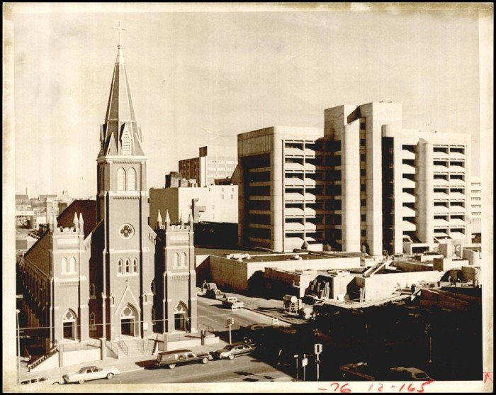 """Photograph used in story by the Oklahoma Times newspaper. Caption: """"Nineteenth Century church of Gothic Design and an almost-finished 20th Century structure of contemporary design make an interesting architectural contrast in downtown Oklahoma City"""""""