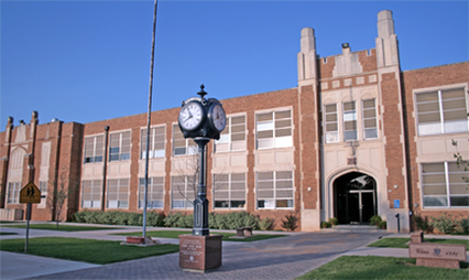 Present day of the front side of the school. This is where many students gather before class starts at 8:00 a.m.