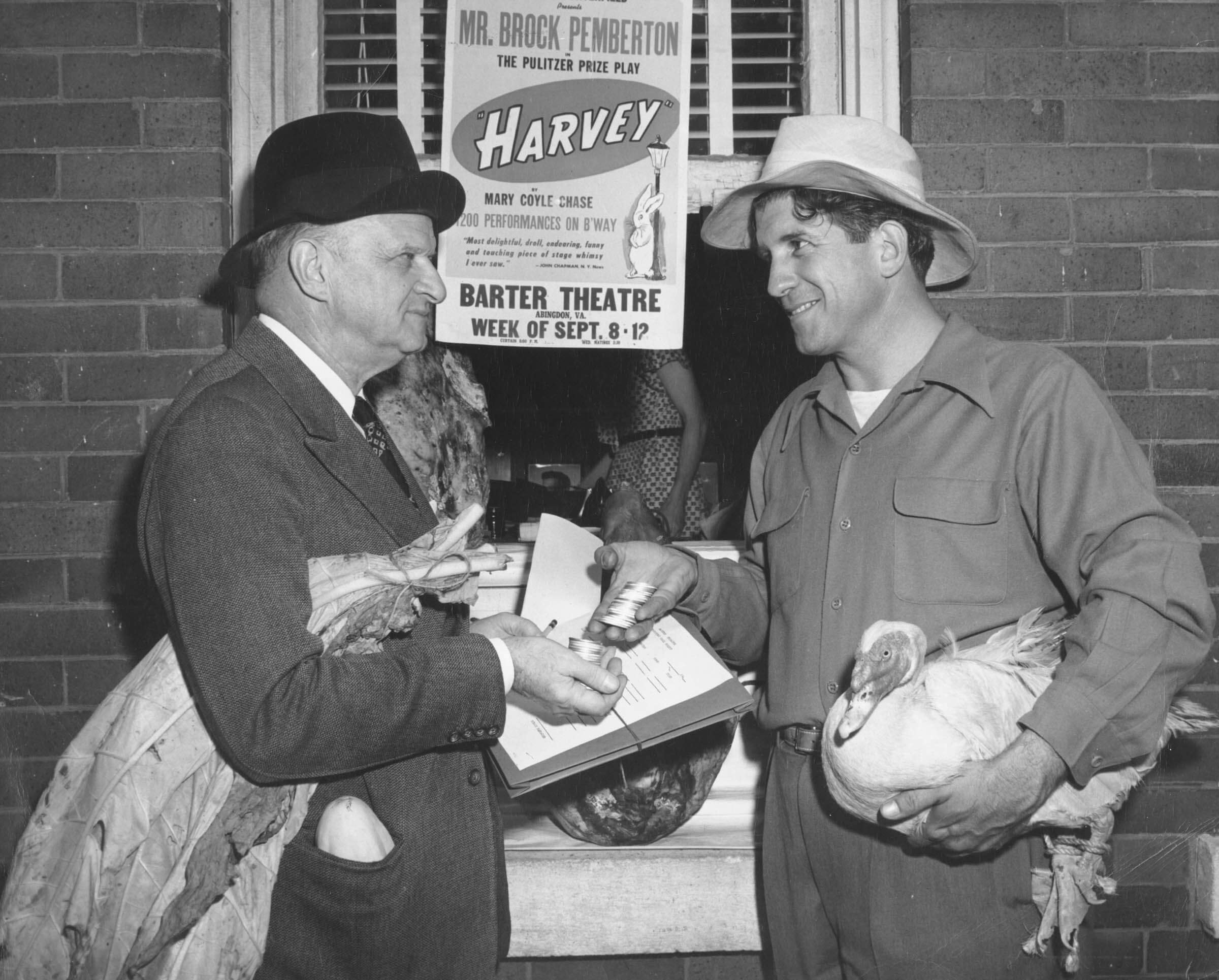 Robert Porterfield and a theatre patron demonstrating a bartering exchange.